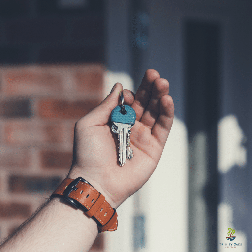 hand holding house keys